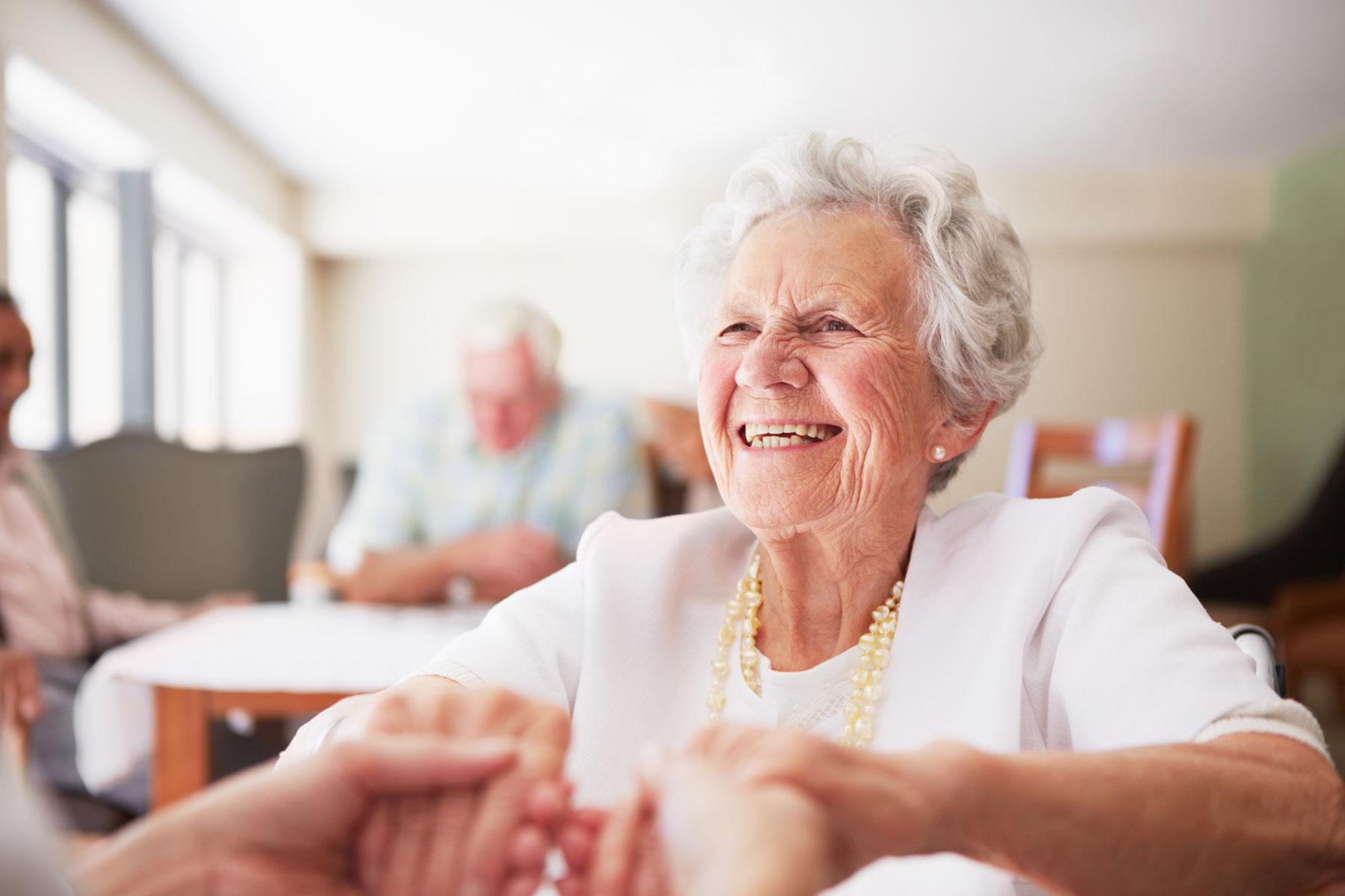 Elderly woman grinning